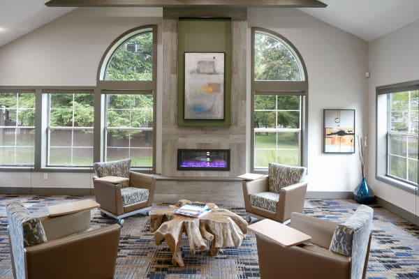 Leasing office lounge area with a fireplace in The Carriages at Fairwood Downs in Renton, Washington