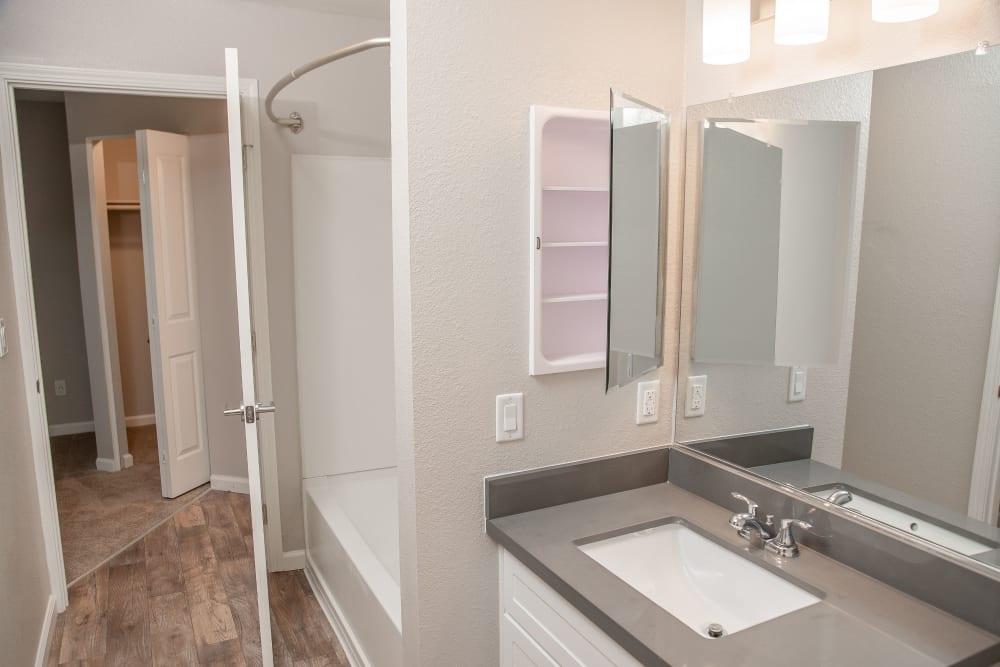 Bathroom with a Vanity mirror and oval tub at Shaliko in Rocklin, California