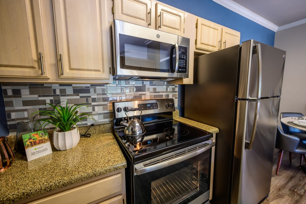 Ample cabinet and cupboard storage in a model home's kitchen at 23Hundred @ Ridgeview in Plano, Texas
