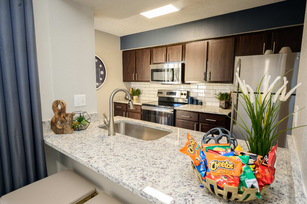 Kitchen with granite countertops at Laurel Heights at Cityview in Fort Worth, Texas