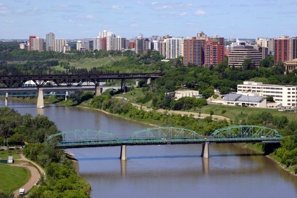 Bridges over a river leading to the city near Touchmark at Wedgewood in Edmonton, Alberta