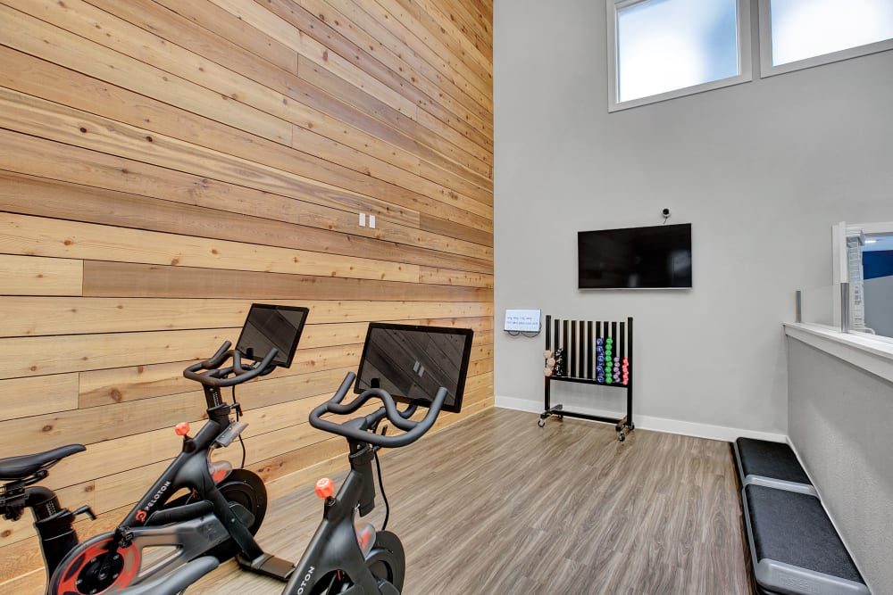 Fitness center with plenty of individual workout stations at Waters Edge Apartments in Kent, Washington