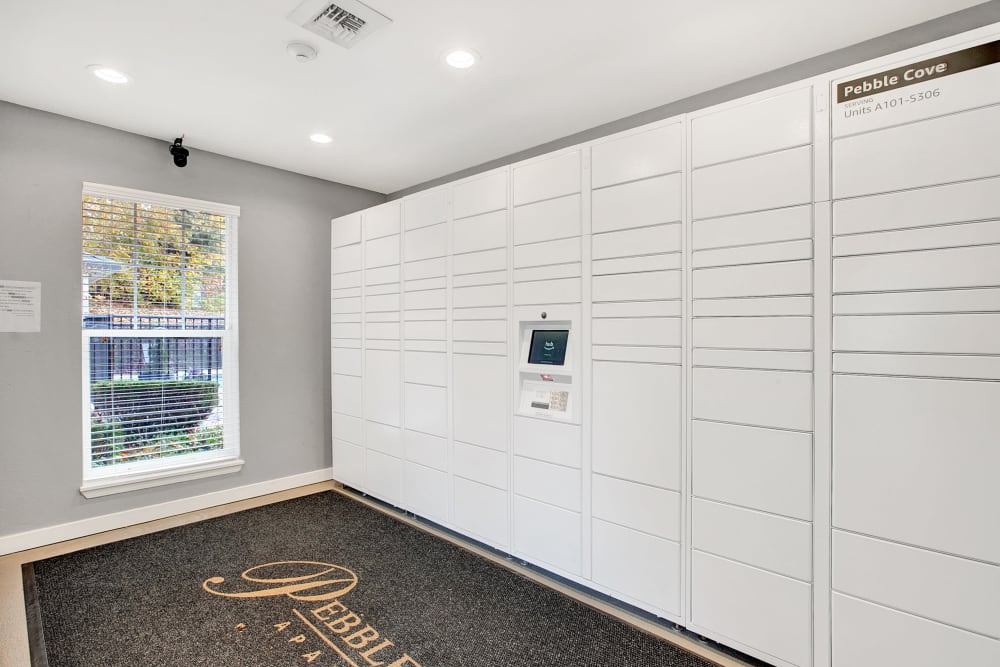 The convenient package room at Pebble Cove Apartments in Renton, Washington