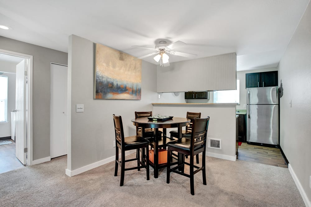 An open dining room at Waters Edge Apartments in Kent, Washington