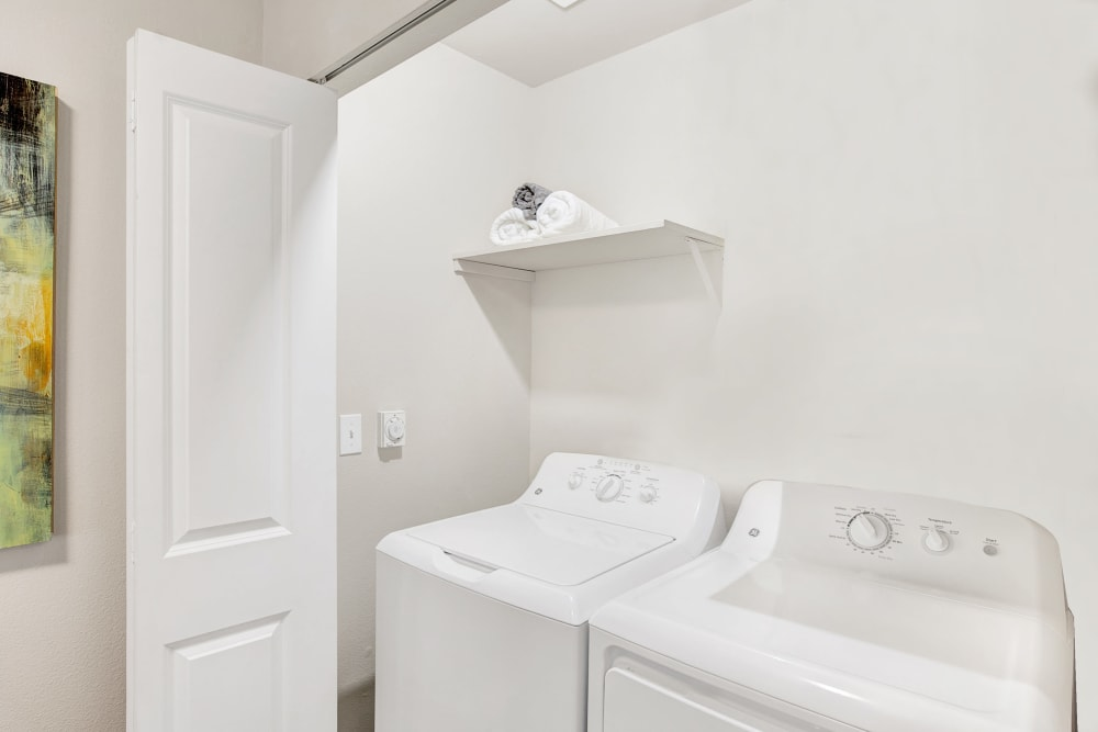 Apartments complete with a washer and dryer at Pebble Cove Apartments in Renton, Washington