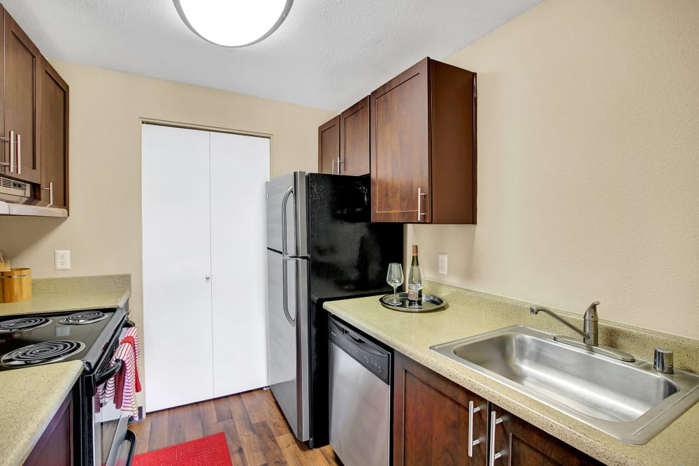 A kitchen with plenty of cabinet space at Waters Edge Apartments in Kent, Washington