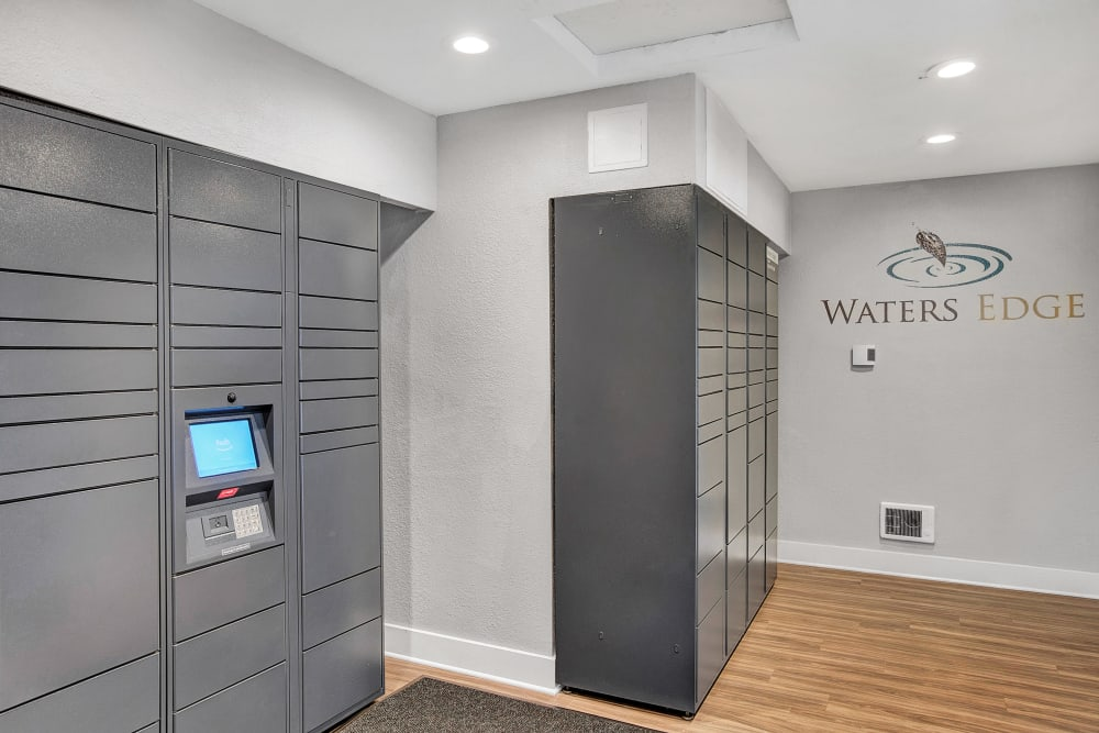 The convenient package room at Waters Edge Apartments in Kent, Washington