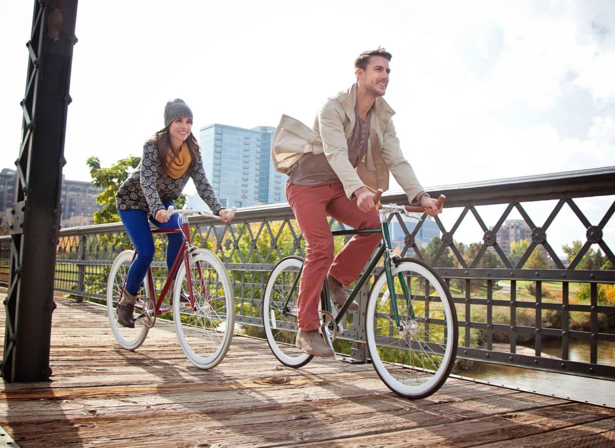 Residents biking near Rippling Stream Townhomes in Durham, North Carolina