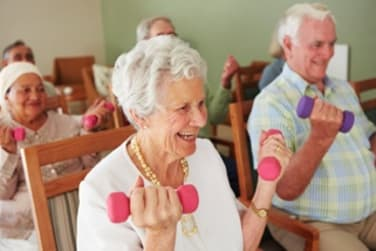 Residents Lifting Weights at Grand Villa of Altamonte Springs in Altamonte Springs, Florida
