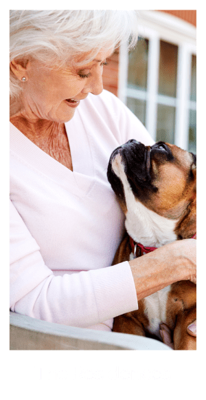 Senior resident holding her dog