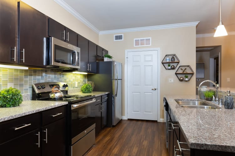 Modern kitchen in a model home at Hilltops in Conroe, Texas