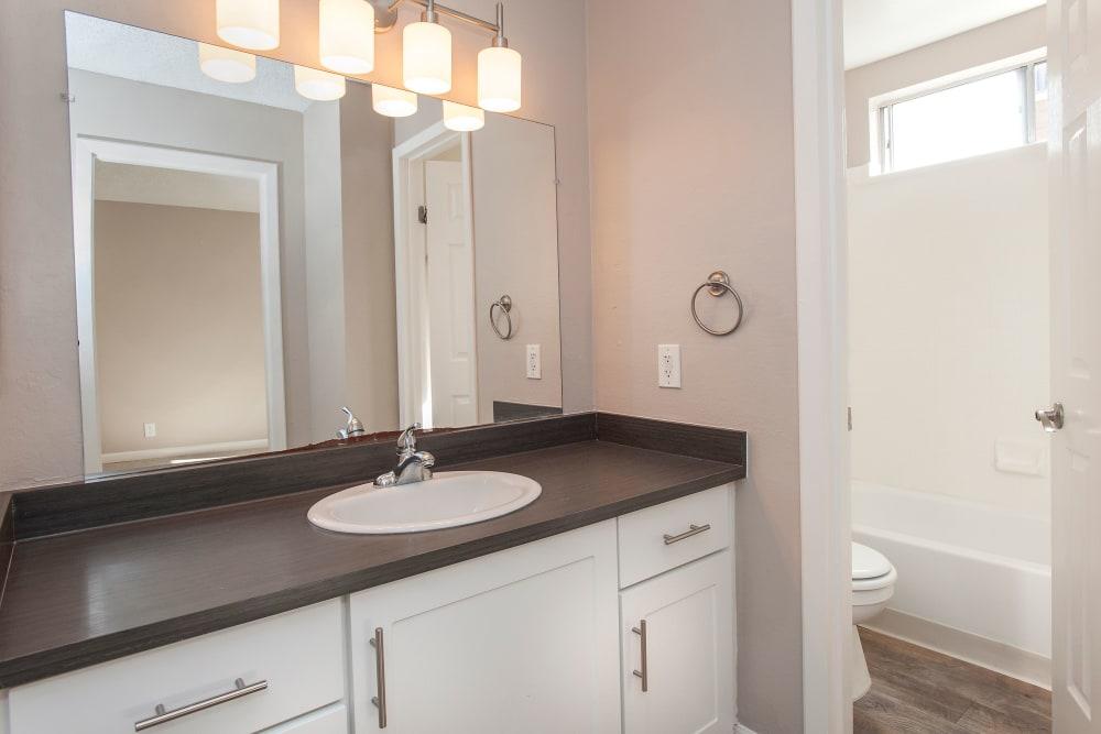Model bathroom with vanity lighting at Flora Condominium Rentals in Walnut Creek, California