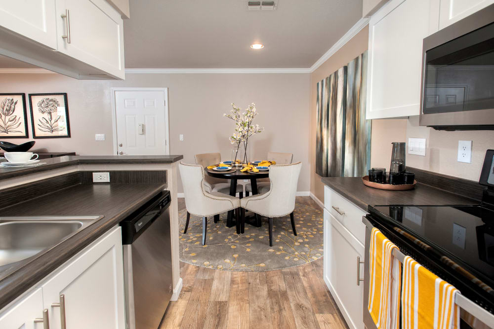 Modern kitchen with white cabinetry at Reserve at Capital Center Apartment Homes in Rancho Cordova, California