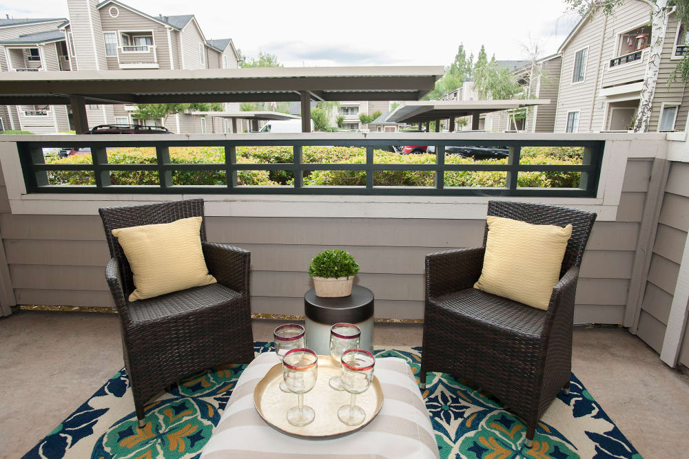 Balcony area with seating at Reserve at Capital Center Apartment Homes in Rancho Cordova, California