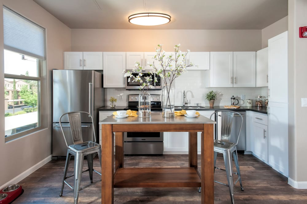 Kitchen with stainless-steel appliances at Venu at Galleria Condominium Rentals in Roseville, California