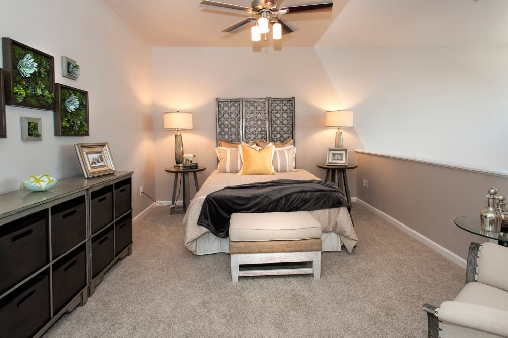 Model bedroom with beautiful ceiling fan at Venu at Galleria Condominium Rentals in Roseville, California