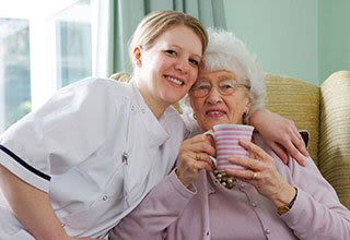 Senior living resident with nurse in New Orleans