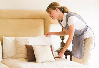 Senior living housekeeping and linen services at Discovery Commons At Bradenton in Bradenton, Florida