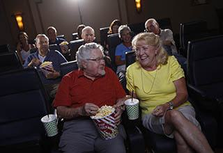Seniors in the movie theater at Discovery Commons At Bradenton in Bradenton, Florida