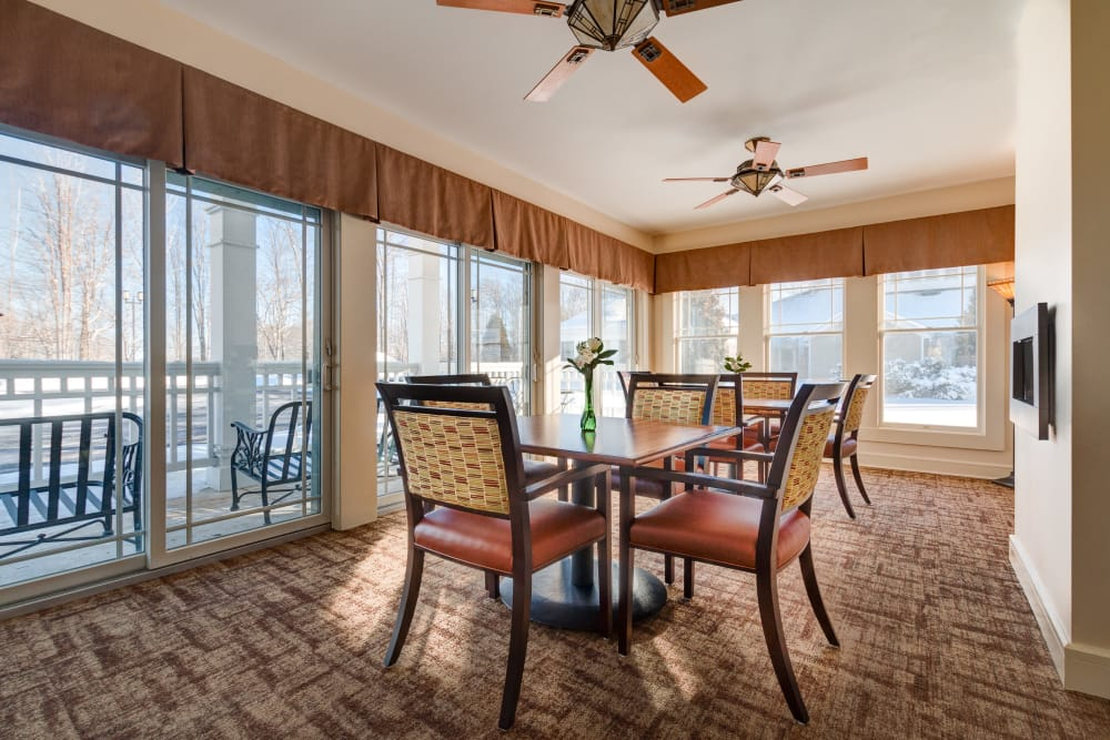 Dining area featuring ceiling fans at Maplewood at Orange in Orange, Connecticut