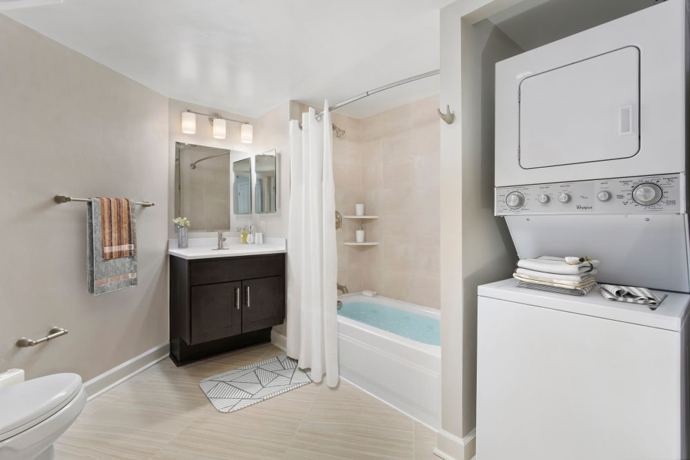 Spacious bathroom with washer and dryer at Alexander House in Silver Spring, Maryland