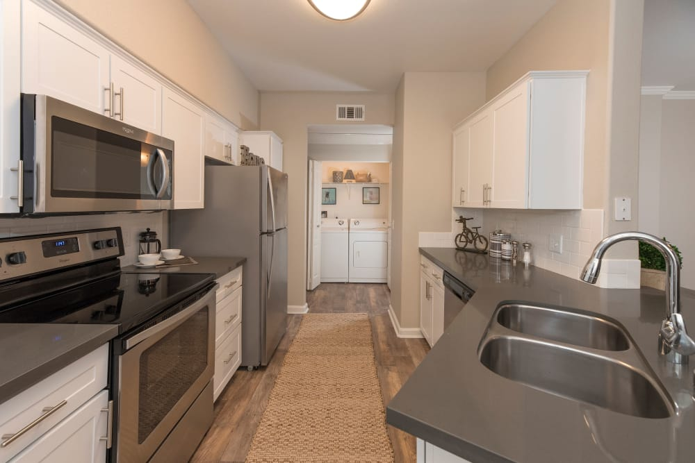 Model kitchen with state-of-the-art appliances at The Artisan Apartment Homes in Sacramento, California
