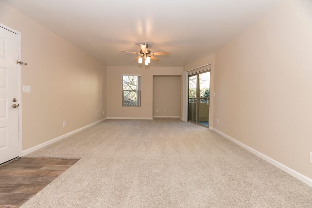 Spacious layout with ceiling fan at Sterling Heights Apartment Homes in Benicia, California