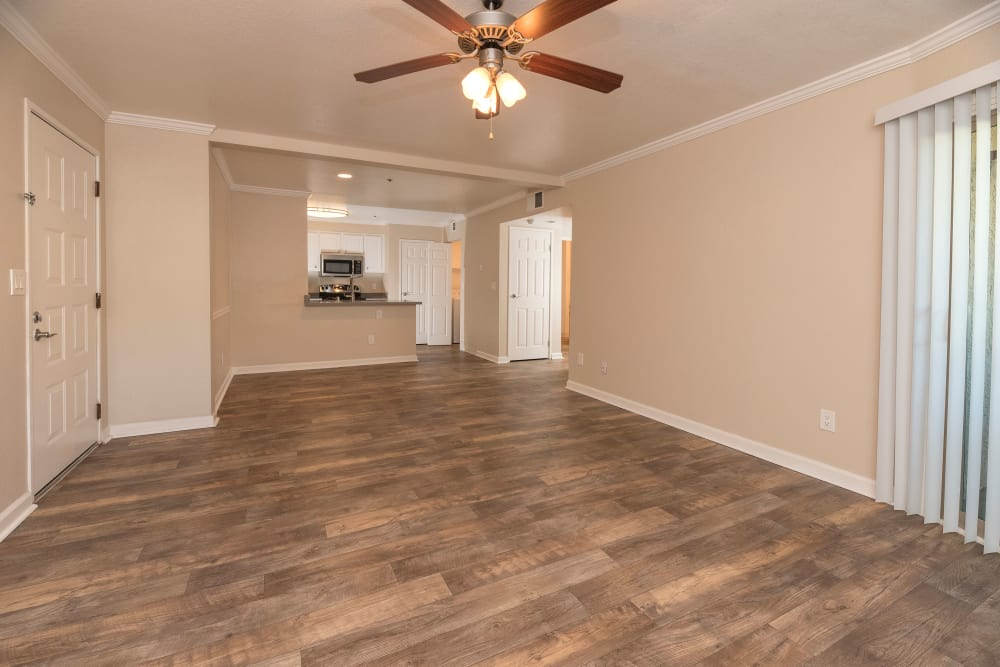 Hardwood floors with ceiling fan at Sterling Heights Apartment Homes in Benicia, California