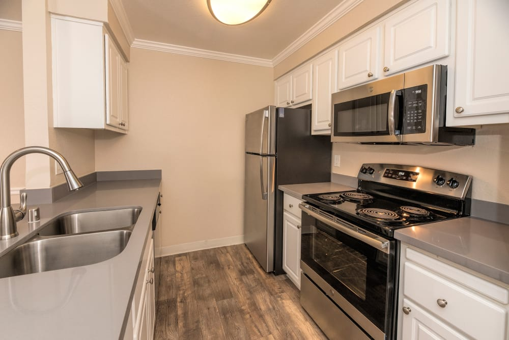 Kitchen with stainless steel appliances at Sterling Heights Apartment Homes in Benicia, California