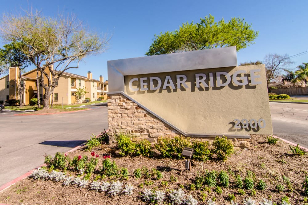 Welcome sign at Cedar Ridge Apartments
