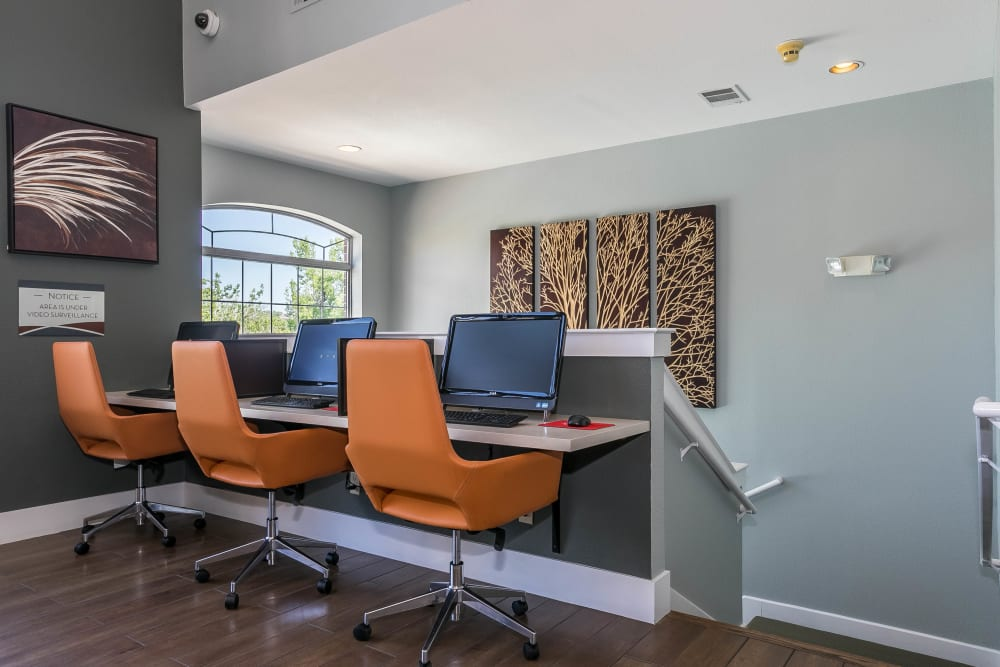 Stay connected with computers in the community business center at The Crossings at Bear Creek Apartments in Lakewood, Colorado