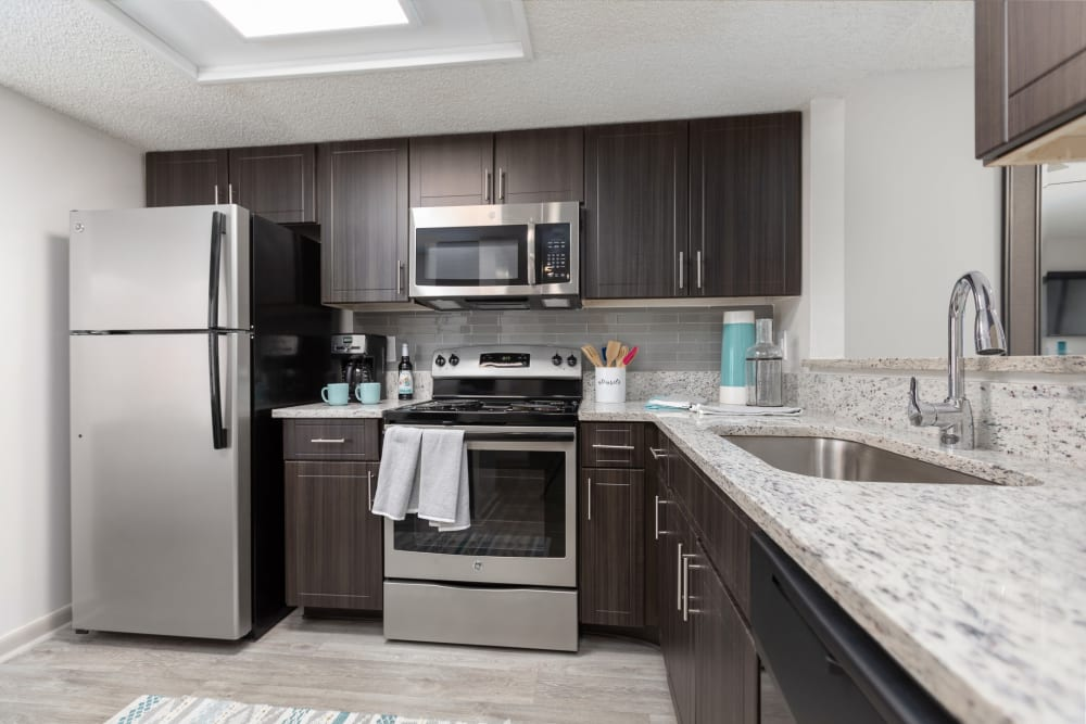 Kitchen with stainless-steel appliances in a model apartment at Siena Apartments in Plantation, Florida