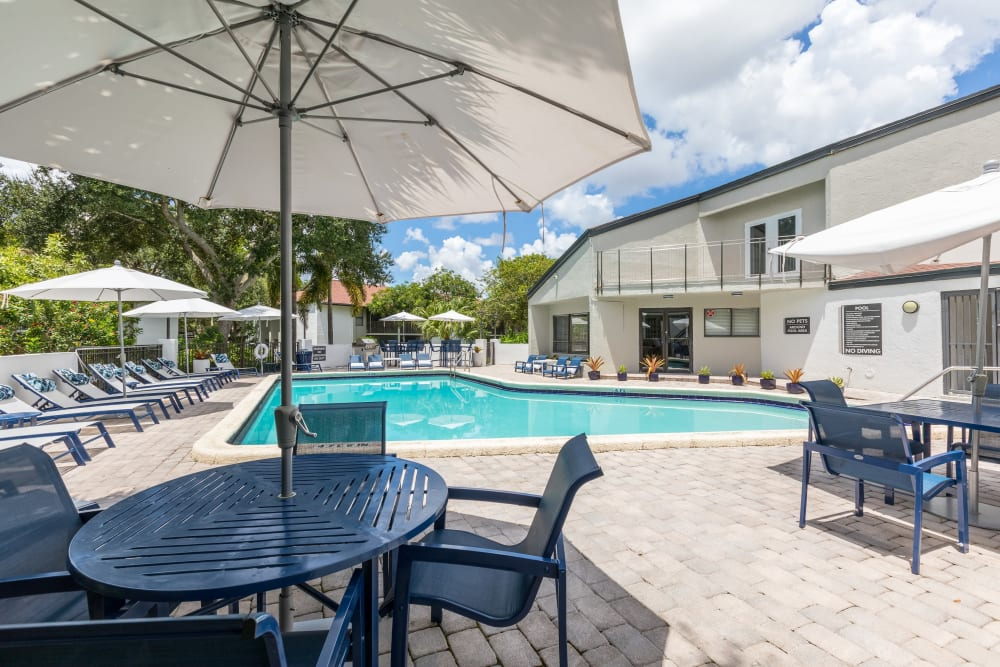Shaded seating areas near the pool at Siena Apartments in Plantation, Florida