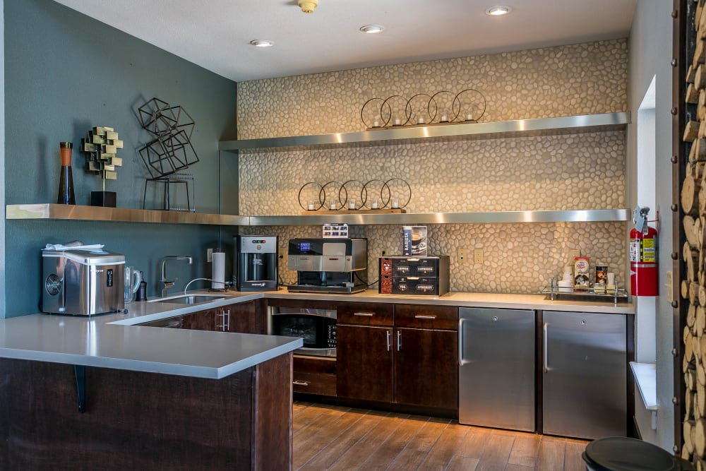 The well appointed community kitchen at The Crossings at Bear Creek Apartments in Lakewood, Colorado