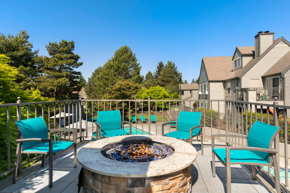 Sundeck and lounge chairs and a fire pit at Meadows at Cascade Park Apartments in Vancouver, Washington
