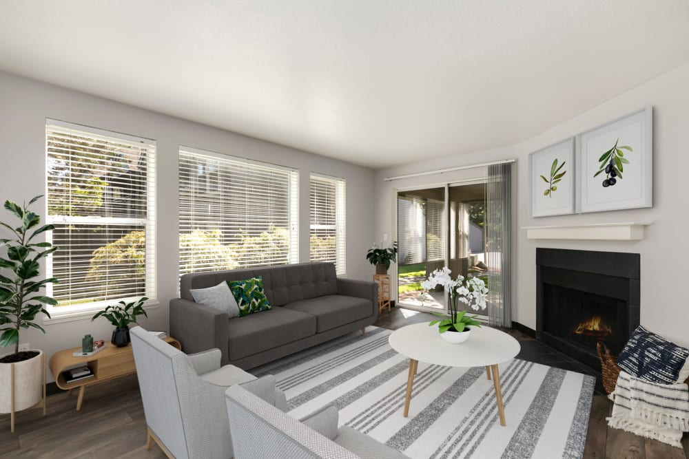 Well-decorated living room with wood-style flooring at Meadows at Cascade Park Apartments in Vancouver, Washington