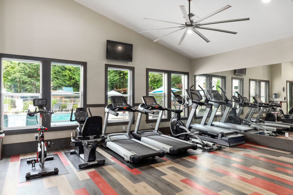 Fitness center with plenty of individual workout stations at Wildreed Apartments in Everett, Washington
