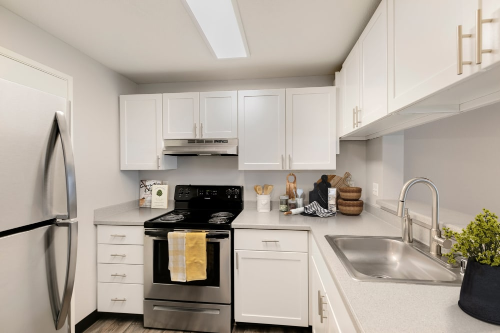 A kitchen with plenty of cabinet space at Meadows at Cascade Park Apartments in Vancouver, Washington