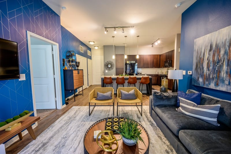 Well-furnished model home's living area at Aspire at 610 in Houston, Texas