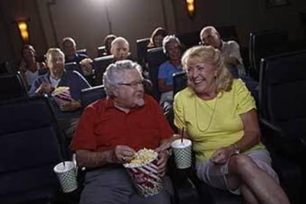 Senior living residents at the movies at Discovery Commons At Wildewood in California, Maryland