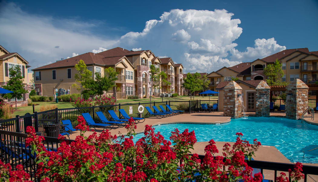 View of Villas at Canyon Ranch's gated community swimming pool in Yukon, Oklahoma