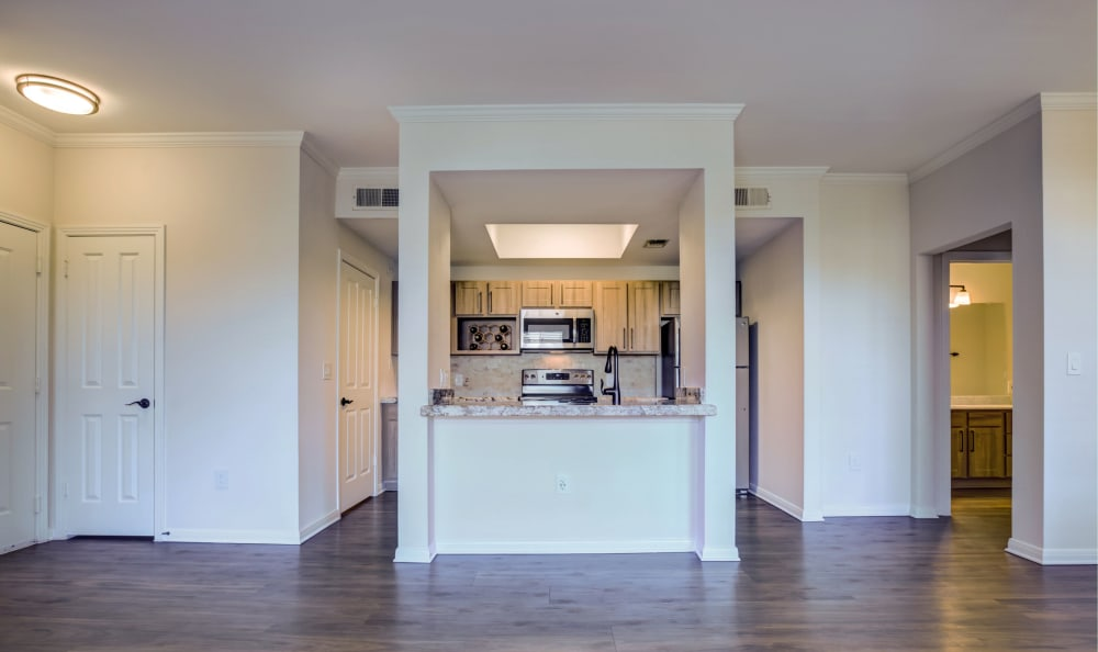 View of kitchen from living room at Riata Austin in Austin, Texas