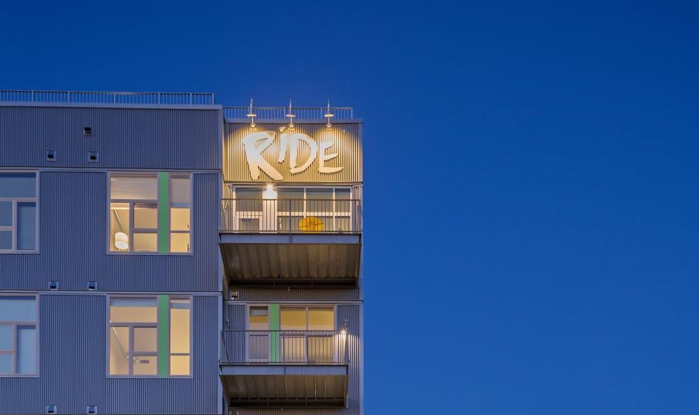 View of the building at dusk at RiDE at RiNo in Denver, Colorado