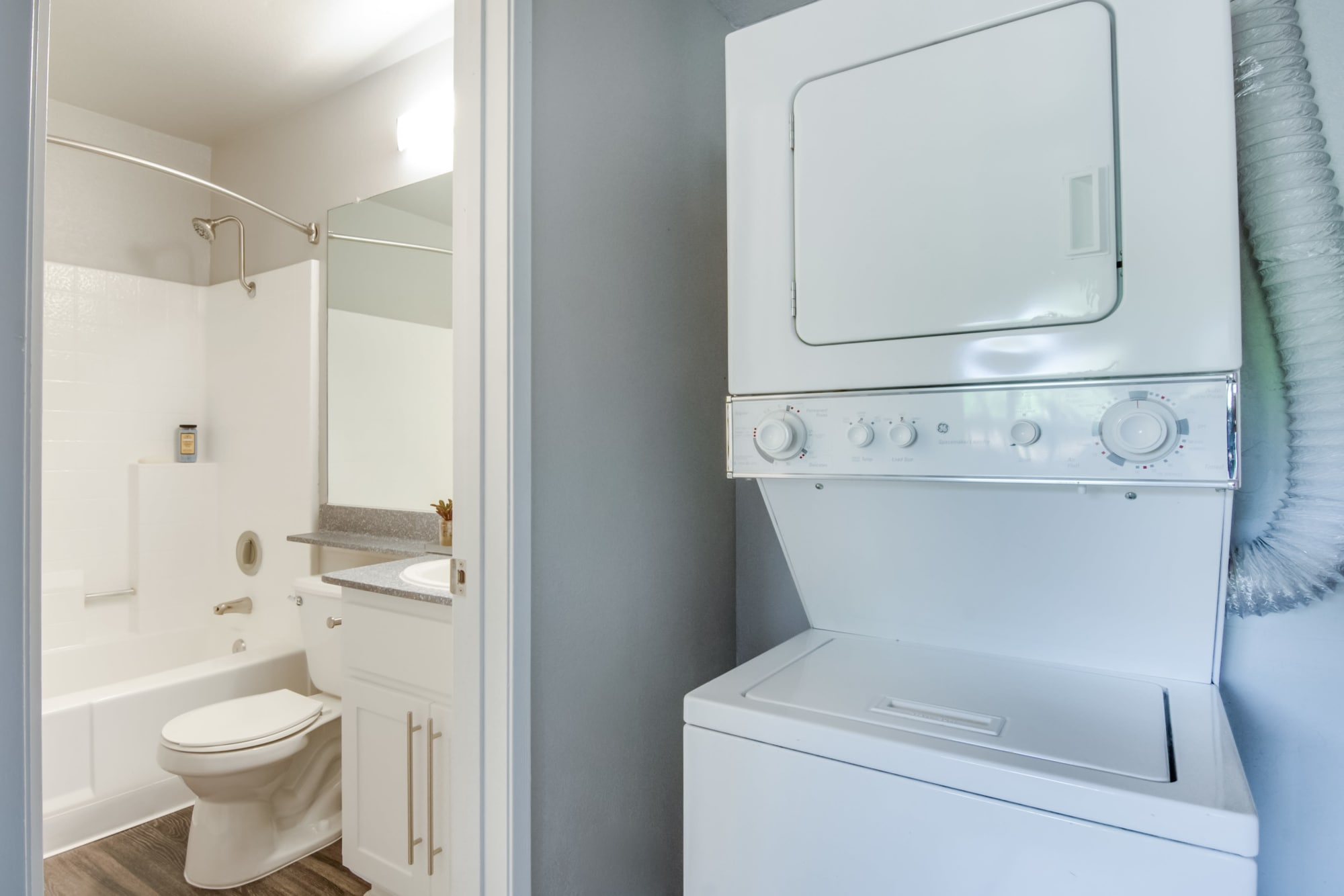 Washer and dryer next to the bathroom at Terra Nova Villas