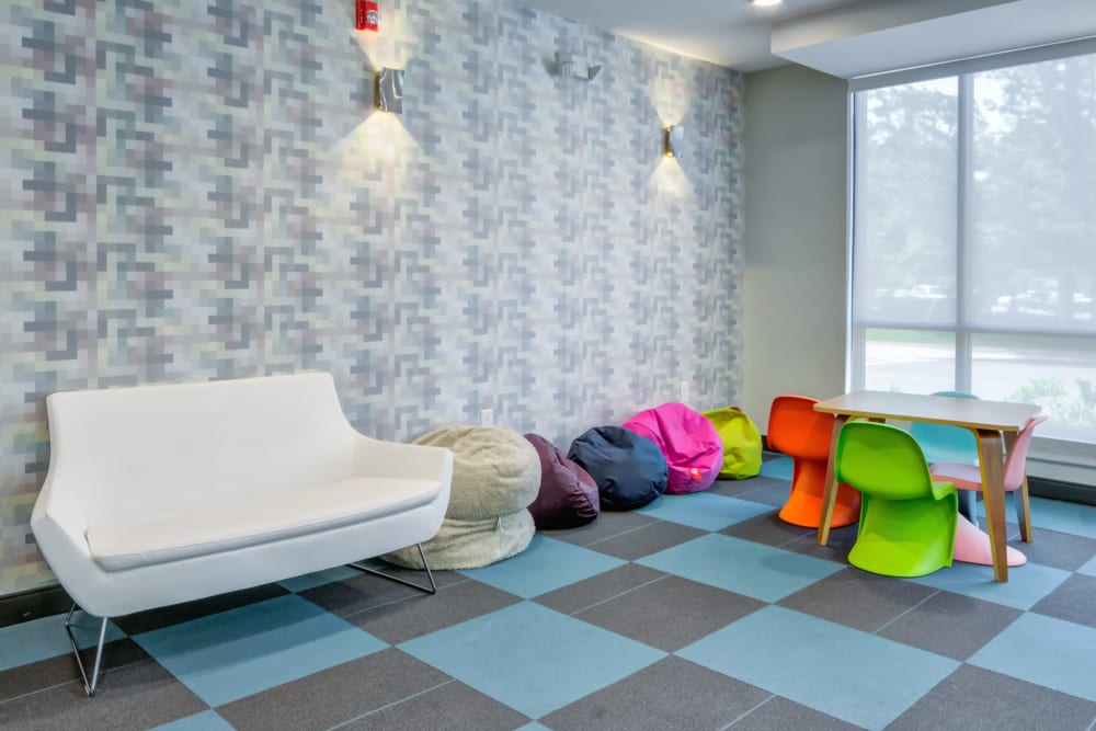 Playful indoor seating area with bean bags at Crossings at Olde Towne