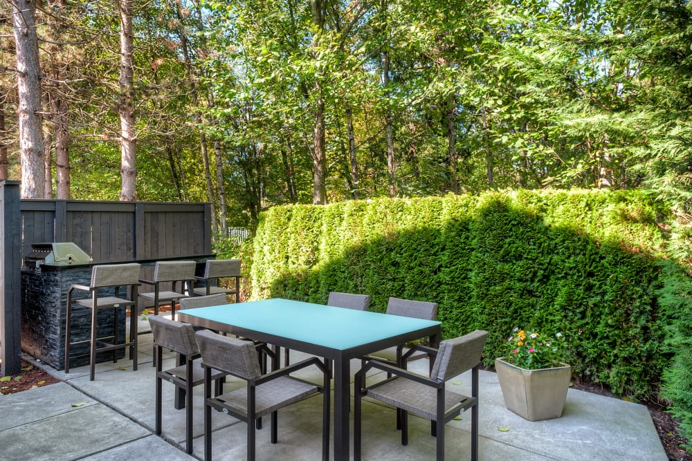 A BBQ lounge area at Karbon Apartments in Newcastle, Washington