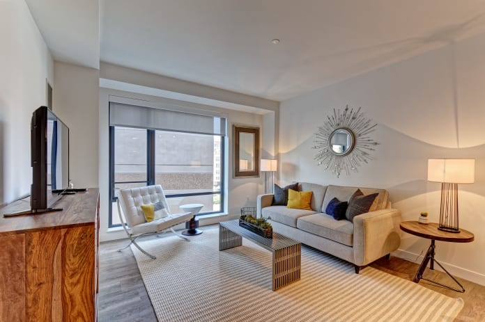 Beautiful living room with a large window at Vela on the Park in Stamford, Connecticut