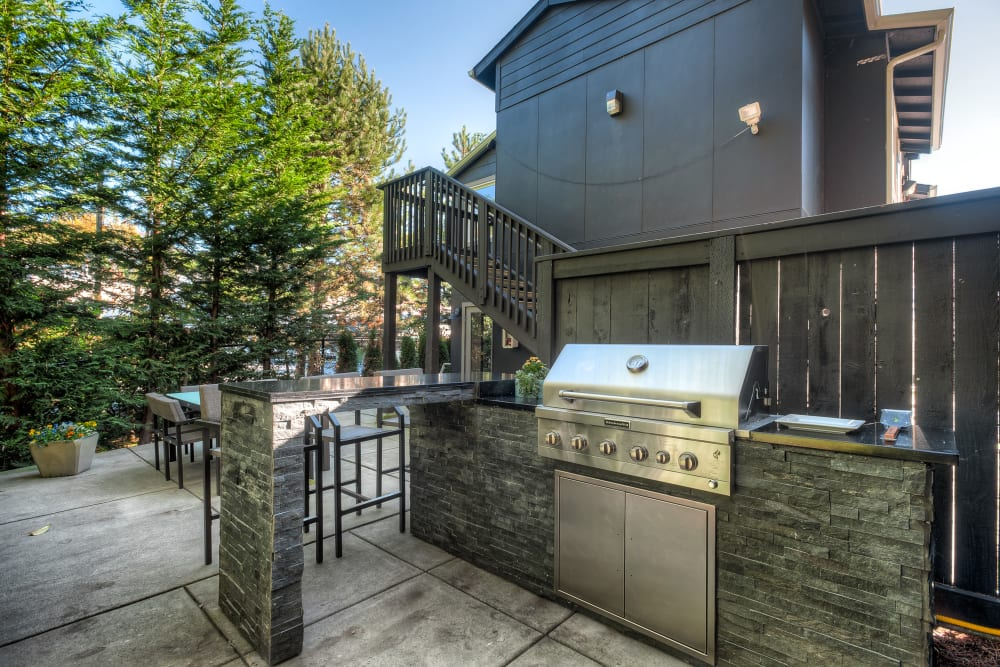 An outdoor BBQ area at Karbon Apartments in Newcastle, Washington
