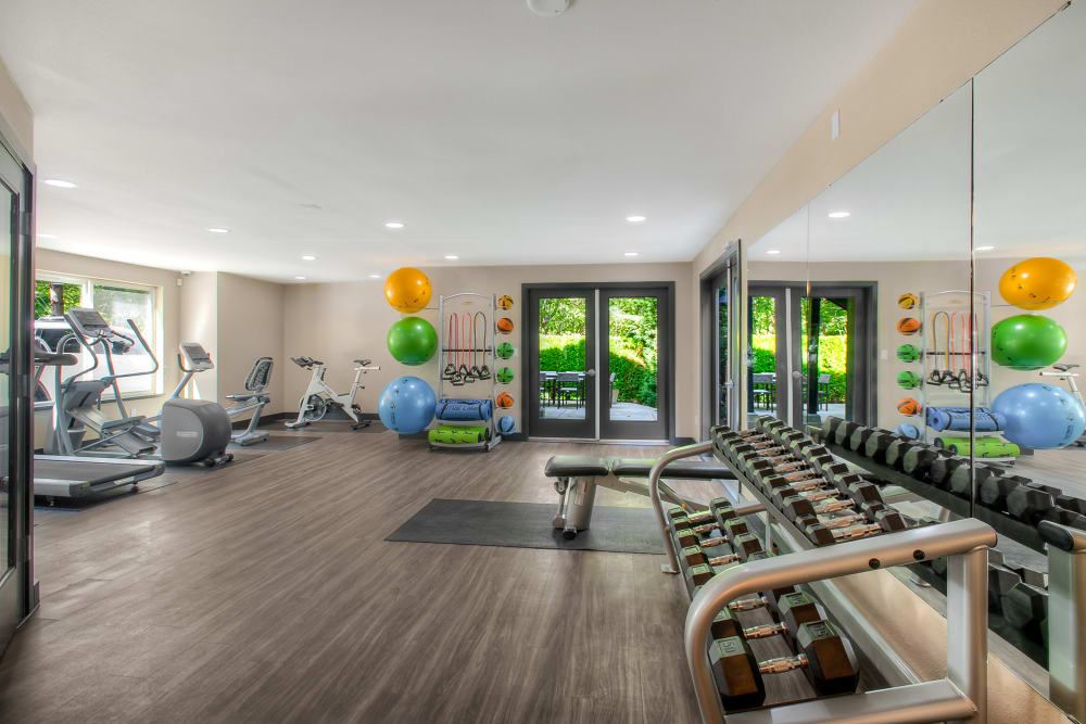 The spacious fitness center at Karbon Apartments in Newcastle, Washington