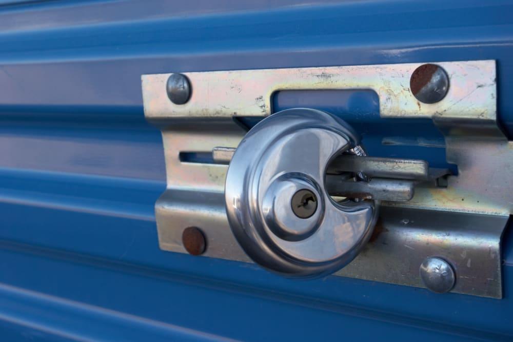 A round lock on a blue storage unit door at Stor 4 Dayz in Sanford, Florida